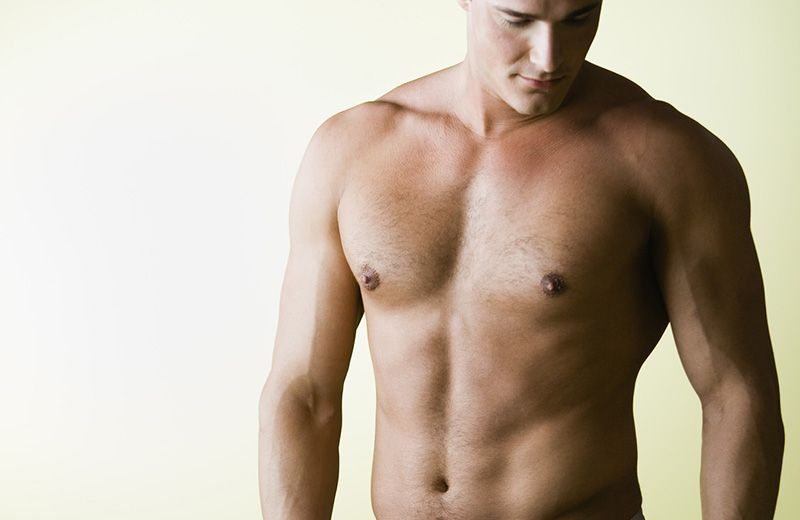 Muscular Young Man with Bare Chest