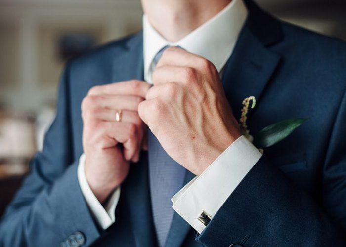 Fashion detail image of a groom wearing a bowtie on his wedding day.